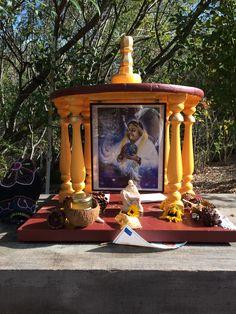 Amma ashram garden altar. Hugging saint blesses world.