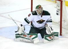 Minnesota Wild goalie Devan Dubnyk (40) makes a save during the second period against the Winnipeg Jets at MTS Centre.  #9227374