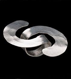 Alexander Calder, (1898-1976) Ring silver wire 2 3/4 x 2 1/4 in. (6.9 x 5.7 cm.) Executed circa 1941.