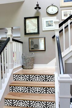 Entry Staircase Makeover Before and Afters. Black and white railings, Hickory wood steps stairs Stairway Gallery Wall, Gallery Walls, Stairwell Wall, Basement Stairs, Mirrors On Stairs, Foyer Wall Decor, Wallpaper Stairs, Staircase Wall Decor, Stair Decor