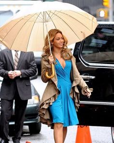 Beyonce cerulean Roberto Cavalli dress paired with an amazing khaki Jillian Lewis ruffled hem trench coat which I would kill for!