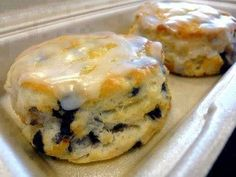iNGREDIENTS : Biscuits: 2 Cups Flour 1 Cup milk (cold) 1/3 Cup sugar 5 T of butter (cold or frozen) 4 tsp baking powder 1 tsp salt 3 oz of blueberries (fresh or dried) Glaze: 1 Cup of powdered sugar 1/8 Cup of water 1 tsp of vanilla ½ tsp of lemon juice Directions: Preheat …