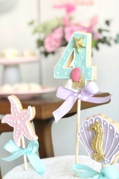 Check out the wonderful mix of cake pops at this under the sea birthday party! See more party ideas and share yours at CatchMyParty.com #catchmyparty #partyideas #4favoritepartiesoftheweek #underthesea #undertheseaparty #mermaidparty #undertheseacakepops #cakepops #girlbirthdayparty