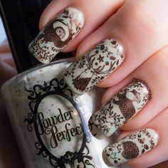 Forest creature nailart using Moyou enchanted 01 plate. Base polish is Powder Perfect Crinoline and stamping polish is  Hit the bottle Expresso Martini.