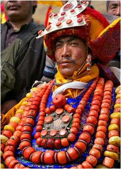 Amdo Tibetan wears family heirloom coral and amber beads in the regional style of regalia. Worth a very great deal indeed if this coral is genuine
