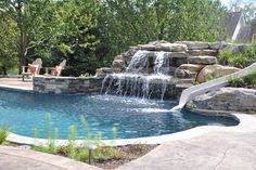 Upper saucon pool with waterslide and swim up bar tropical-pool