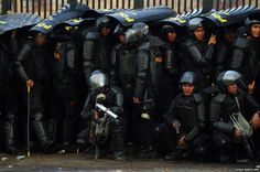 Indonesian riot police take cover outside the university in Makassar during clashes with protesters who are against a 30% increase in fuel prices. The move is an attempt to save the economy more than $8bn (£5bn) in 2015. The subsidised fuel prices in Indonesia are among the cheapest in the world.
