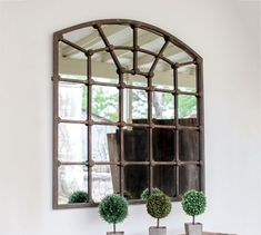 Arched Iron Mirror Big in size and long on good looks. This piece is not just a mirror but a complete decoration too. The iron frame divides the mirror into pan Arched Window Mirror, Entryway Mirror, Arch Mirror, Metal Mirror, Entryway Furniture, Arched Windows, Mirror Set, Window Mirror Decor, Arched Wall Decor