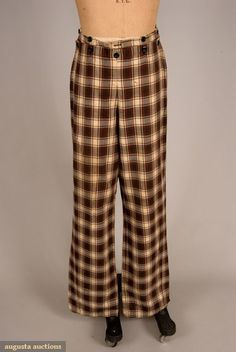 GENTS COTTON PLAID TROUSERS, 1840-1860 Tasha Tudor Historic Costume Collection Twill woven in plaid of red, brown, cream and yellow, broad front, high waistband with eleven black buttons, one watch and two welt pockets in waistband, very long straight legs, hand sewn, white tabby cotton lining, (scattered stains, small tear 6 above hem) good.