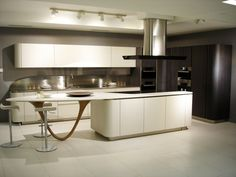 Ola20 with Nordic white micalized lacquered doors and work top in inox, glass and Corian