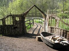 Willow arch and coracle by the lake, Wakehurst Place. Wakehurst is Kew Gardens' place in the countryside near Ardingly