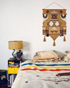 Striped sheets, wall textile, dinosaur lamp.