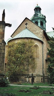 (Annenkapelle), erected in 1321, which remained nearly undamaged during World War II. Also, climbing the wall of the cathedral's apse is the legendary 1000-year-old rosebush, which symbolizes the prosperity of the city of Hildesheim. According to the legend, as long as the bush flourishes, Hildesheim will not decline. In 1945 allied bombers destroyed the cathedral, yet the bush survived. Its roots remained unscathed beneath the rubble, and soon the bush was growing strong again.