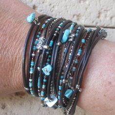 Boho Brown Leather Triple Wrap Bracelet with Turquoise and Silver Accents, Nine Seperate Strands. 50.00, via Etsy.