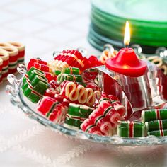 Ribbon Candy Centerpiece:   Place a simple red votive on a crystal dish. Surround the candle with rich red and green ribbon candies for this easy and colorful centerpiece.