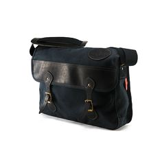 A Waxed Canvas Messenger Bag from Frost River in Duluth, MN. Classy, timeless, premium leather, solid brass hardware. Made in USA, Guaranteed for life.