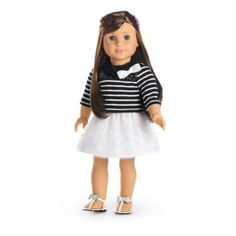 Grace's Sightseeing Outfit -Grace is ready to see the sights in Paris! This French-inspired outfit features: A striped tee with three-quarter sleeves, sequin embellishments, and a pretty white bow at one shoulder A full white skirt with a layer of polka-dot mesh Strappy white sandals with silvery bows Z
