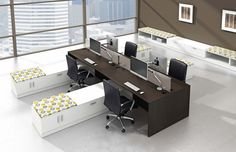 Free standing, open-plan benching type workstations that do not use panels but rather storage and desk top screens to divide the desks and seating areas. New trends in office design are moving away from the typical cubicle. www.ofw.com