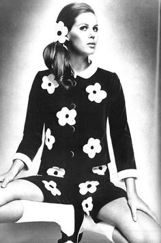 1960s fashion dress. scattered bold flowers pop off the black dress // effect is unreal