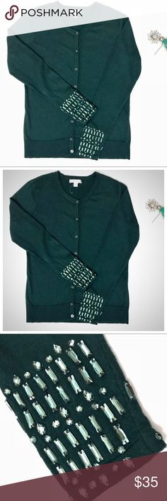 NY&Co Embellished Sleeve Button Up Green Sweater Dark Forest Green Button up Cardigan with green stone embellished sleeve Cuffs. Gilded sleeves along with crystal buttons make this the ideal sweater this Holiday Season 🎄                                            Scoopneck. Button-front closure. Ribbed bottom band and sleeve cuffs. Full sleeve. New York & Company Sweaters Cardigans