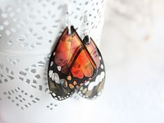 Orange earrings for women gift for girlfriend gift Butterfly earrings Resin jewelry Orange jewelry Gift for nature lover gift Unique jewelry These unique orange butterfly earrings are cute and very light. Convex on both sides, and like candy! Butterfly wings are especially beautiful in the daylight, shining of its pure color in the sun. But if you wear them in the evening, they will be light translucent, saving its unique magic. I love nature and all my jewelry made with love! • I hasten ...