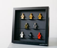 Another LEGO minifig display in a RIBBA frame using the Collectibles 3x4 plates and a cardboard(?) background.