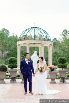 Couple photography in park with stone and iron gazebo