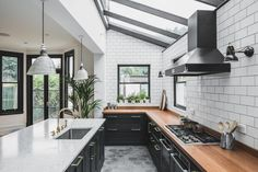 This classic Shaker Kitchen with beaded frame is anything but traditional with a heavy dose of industrial style and unique vintage elements.