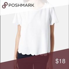 Topshop scalloped tee. Topshop scalloped tee. Color: white. Fits like a size 0. Photo courtesy Nordstrom. Topshop Tops Tees - Short Sleeve