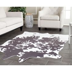 Safavieh's Faux Cowhide collection is inspired by timeless designs crafted with the softest polyester available.