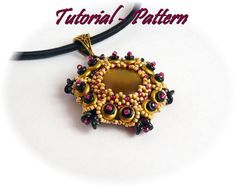 Beading pattern of beaded pendant Ilang PDF instructions by Tiszi - smukt olivenfarve cabochon Used materials: 20 mm flat cabochon, SuperDuo, O beads, 2hole lentil beads, seed beads.