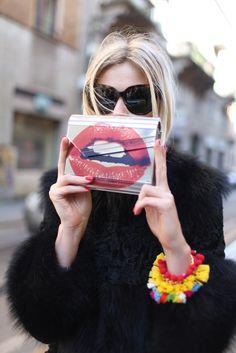 Kiss, kiss. / Statement clutch + black fur + bold bracelet.