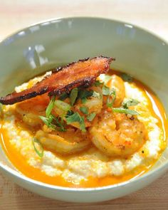 Shrimp and grits is a classic comfort dish -- this version from TV chef Sarah Mastracco includes two types of cheese and a splash of white wine for added flavor.