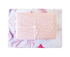 3 pack of Double sided boutique wrapping paper with hand marbled design complimented with polka dots on the other side.