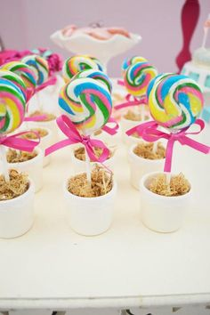 CUTE! Lollipops growing out of flower pots at a party #partyideas #birthday #shower