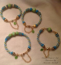Custom made aqua and lime Kumihimo bracelets for Terri's golf team. To order a similar piece, reference CB504,