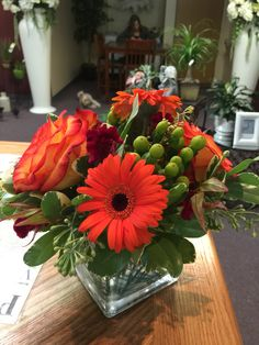 Orange Gerber's with high magic roses