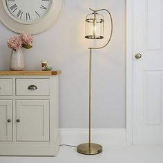 This traditional antique brass floor lamp is designed with a slim metal stand that has a curved arm attached that holds a hanging glass lantern. Antique Brass Floor Lamp, Gold Floor Lamp, Floor Lamp Shades, White Floor Lamp, Apartment Lighting, Standard Lamps, Grey Flooring, Look Vintage, Home Furnishings