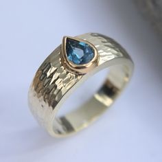London blue topaz white and yellow gold setting