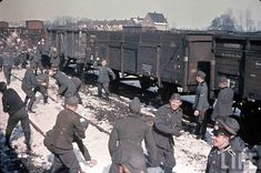 Nazi soldiers having a snowball fight in France during WWII.