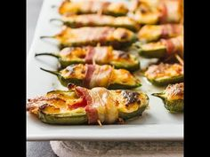 You'll love these bacon wrapped jalapeño peppers stuffed with cream cheese and shredded cheddar. Super easy, only 5 ingredients, low-carb, and can be baked!