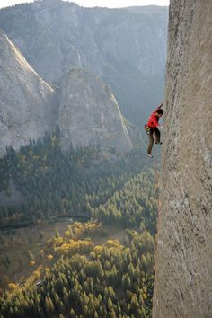 """The real wonder is the athleticism and fearlessness of  the people who free solo Yosemite's sheer rock faces. That means virtually gear and no safety rope. You fall, you die. As the caption reads: You need training to boost finger strength and a mountain of determination to grip the teeny holds along this mostly blank expanse of El Cap. Even though Kevin Jorgeson's been climbing parts of the route for three years, he was amazed by this photo: """"There's so little of me touching the wall."""""""