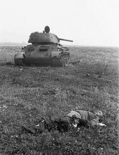 "Soviet ""tankista"" lies dead near his knocked out T-34. Near Belgorod, 1943."