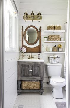 Master bathroom makeover featuring a turned leg vanity, vintage mirror, floating shelves, industrial gold light fixture, gold faucet, and shiplap walls.