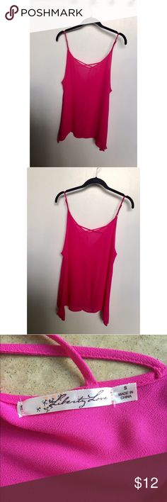 Bright pink tank with cross back detail. Bright pink tank with cross back detail. Worn once. Great condition! Tops Tank Tops