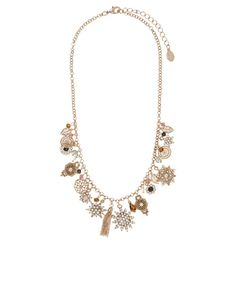 Shine bright with our Helena sparkly charm necklace, decorated with embellished star and flower pendants, tassels, filigree discs and beads. Features a lobst...