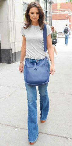 Katie Holmes went back to basics with a slate gray tee tucked into flared MiH jeans. A single gold bracelet, a blue cross-body bag, and platform sandals completed her effortlessly stylish look.