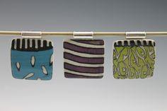 © 2014 Ann Lindell Ceramics 3 square pendants. Layered porcelain, sgrafitto, clear glaze, ^6 oxidation