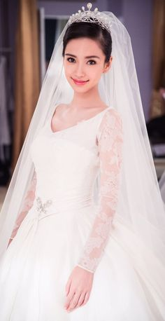Angelababy wore a fairytale dress by Christian Dior. The dress was Ivory satin organza, tulle and Chantilly lace. The dress featured a train and took 5 months to create. Angelababy topped her look with a custom diamond tiara by Parisian Jeweler Chaumet. Dior Wedding Dresses, Wedding Dress Accessories, Bridal Dresses, Wedding Gowns, Asian Bridal Makeup, Bridal Makeup Looks, Angelababy Wedding, Wild Campen, Kim And Kanye
