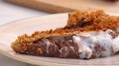 Cast-Iron S'mores Calzone   There's nothing better than a classic s'mores, but we love coming up with ways you can enjoy the tasty treat sans firepit. To mimic the graham cracker part of the summer staple, we combined graham cracker crumbs with melted butter and salt and brushed it all over a chocolate and marshmallow-filled calzone. As it bakes, the mixture creates a salty graham cracker crust for the calzone, adding delici...